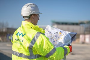 Image of Ancala Water Services employee wearing branded ppe on construction site looking at map